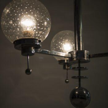 Big pair of Art Deco ceiling lamp in chromed steel at Studio Schalling
