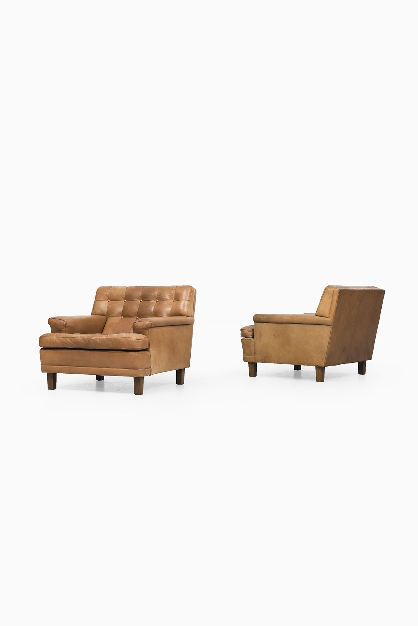 Arne Norell Merkur easy chairs in cognac brown leather at Studio Schalling