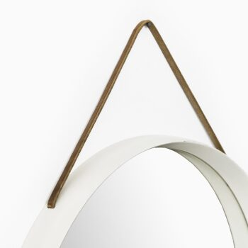 White lacquered round mirror with leather strap at Studio Schalling