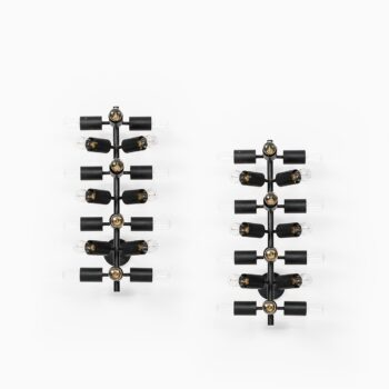A pair of wall lamps in black lacquered metal at Studio Schalling