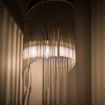Art Deco wall lamp in brass and glass at Studio Schalling