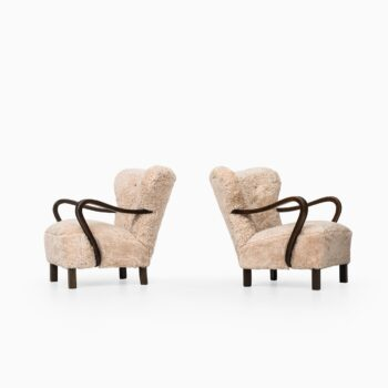 Pair of easy chairs in sheepskin from the 1940's at Studio Schalling