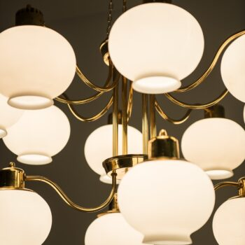 Big ceiling lamps in brass and opal glass at Studio Schalling