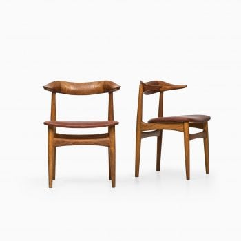 Knud Færch cowhorn dining chairs at Studio Schalling