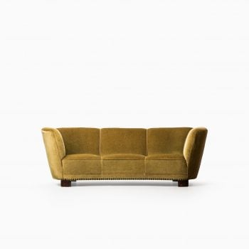Large curved sofa in green / yellow velvet at Studio Schalling