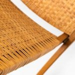 Hans Wegner folding chair in oak and cane at Studio Schalling
