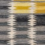 Ingrid Dessau carpet in grey and yellow at Studio Schalling