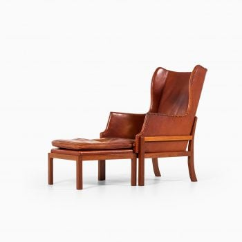 Mogens Koch wingback easy chair with stool at Studio Schalling