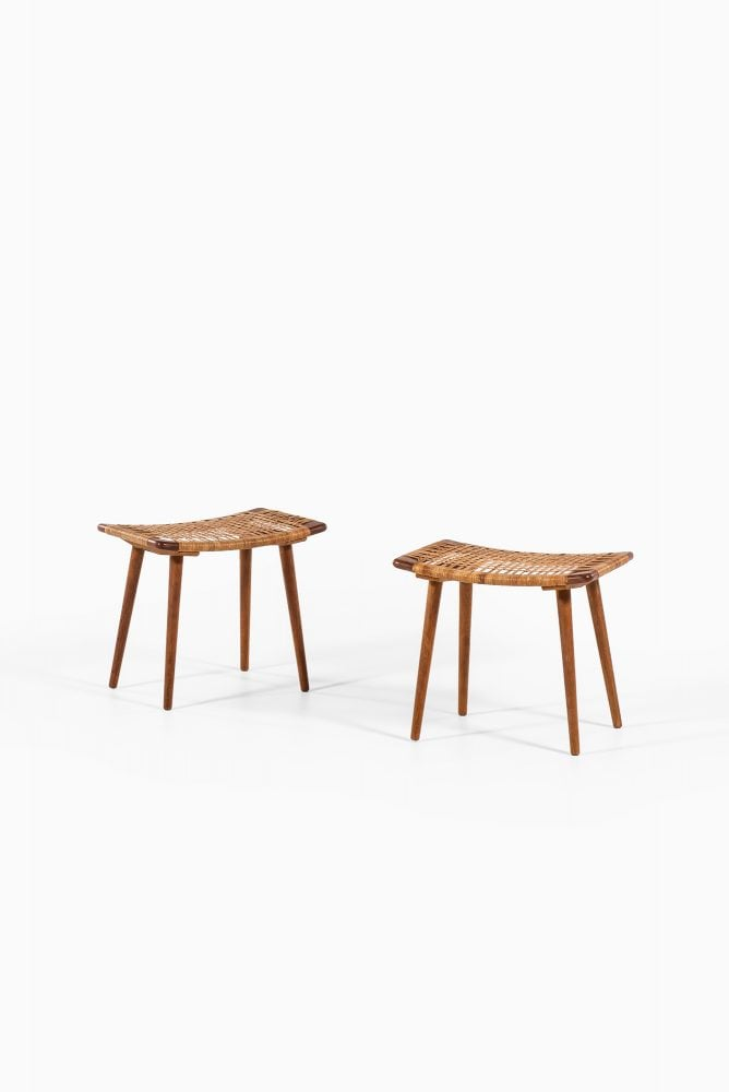 A pair of stools in oak and woven cane at Studio Schalling