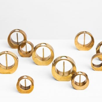 Arthur Pe set of 10 candlesticks in brass at Studio SchallingArthur Pe set of 10 candlesticks in brass at Studio Schalling