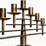 Heavy candlestick in brass from Denmark at Studio Schalling