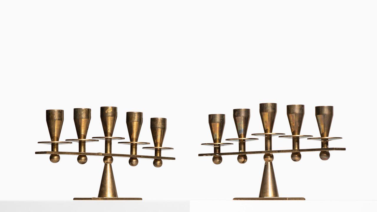 Pair of heavy candlesticks in brass by Kara at Studio Schalling