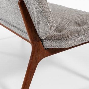 Sofa in teak with grey wool fabric at Studio Schalling