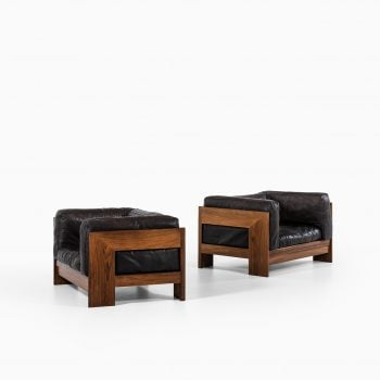 Pair of easy chairs in rosewood and leather at Studio Schalling