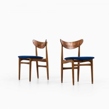 Dining chairs in oak, teak and blue fabric at Studio Schalling
