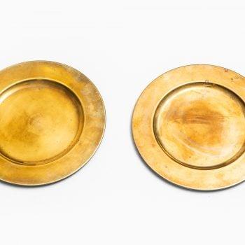 Brass coaster plates by Stelton at Studio Schalling