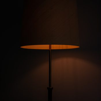 Pair of floor lamps in rosewood by Bergbom at Studio Schalling