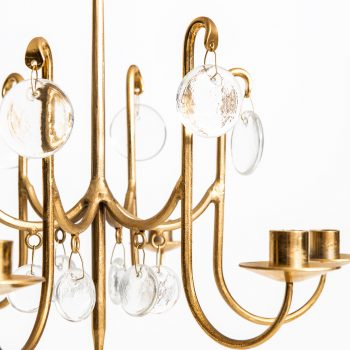 Erik Höglund chandelier in brass and glass at Studio Schalling