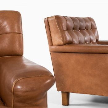 Arne Norell Merkur easy chairs in buffalo leather at Studio Schalling