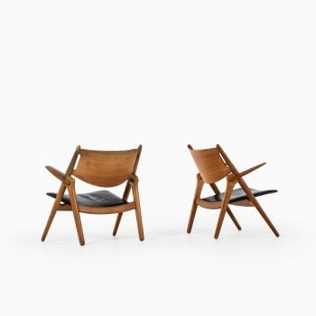 Hans Wegner CH-28 easy chairs in oak at Studio Schalling