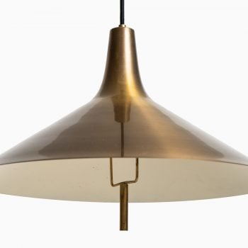 Height adjustable ceiling lamp in brass at Studio Schalling
