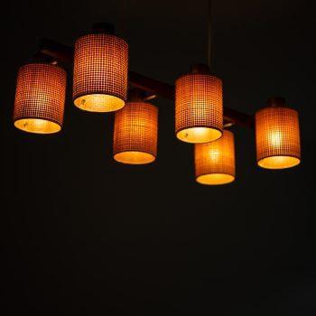 Hans Bergström ceiling lamp in brass and teak at Studio Schalling