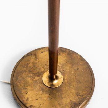 Böhlmarks floor lamps in brass and mahogany at Studio Schalling