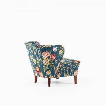 Gösta Jonsson easy chair in beech and floral fabric at Studio Schalling