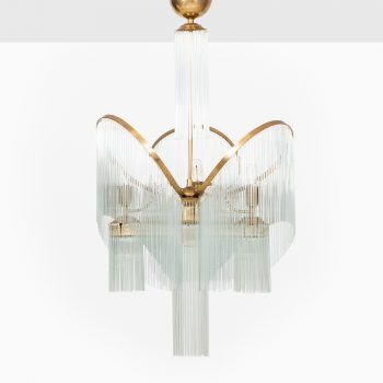 Massive Art Deco ceiling lamp in brass at Studio Schalling