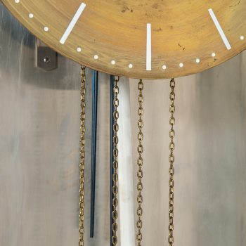 Modernist grandfather clock in steel at Studio Schalling