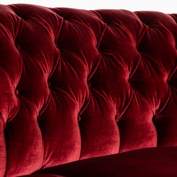 Large freestanding curved sofa in red velvet at Studio Schalling