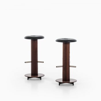 Bar stools in rosewood and black leather at Studio Schalling