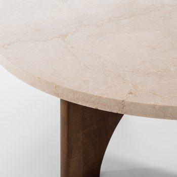 Round coffee table in mahogany and stone at Studio Schalling