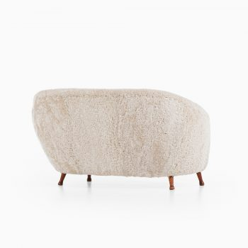 Arne Norell sofa in dark stained beech and sheepskin at Studio Schalling