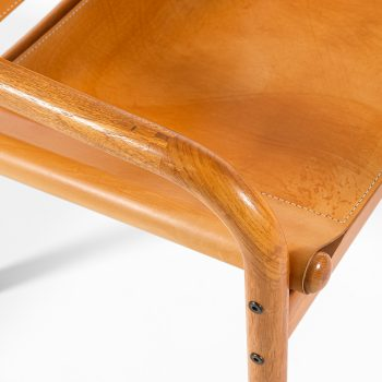 Easy chairs in oak and cognac brown leather at Studio Schalling