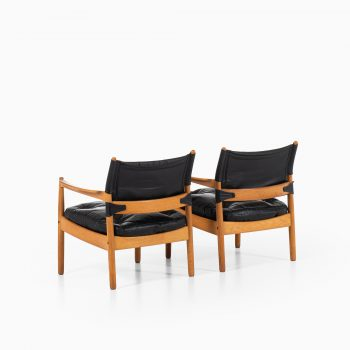 Gunnar Myrstrand easy chairs in oak and black leather at Studio Schalling