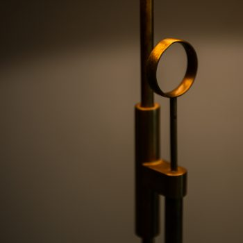 Height adjustable floor lamp in brass at Studio Schalling