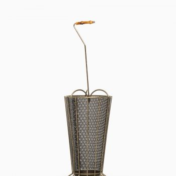 Umbrella stand in brass and black lacquered metal at Studio Schalling