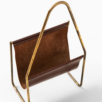 Carl Auböck magazine stand in brass and leather at Studio Schalling