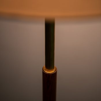 Pair of floor lamps in brass and rosewood at Studio Schalling