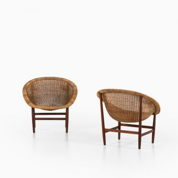 Nanna & Jørgen Ditzel easy chairs in teak and rattan at Studio Schalling