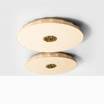 Pair of flush mount ceiling lamps in brass at Studio Schalling