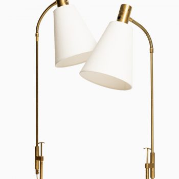 Pair of floor lamps in brass by Falkenbergs belysning at Studio Schalling