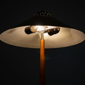 Table lamp in brass, teak and leather at Studio Schalling
