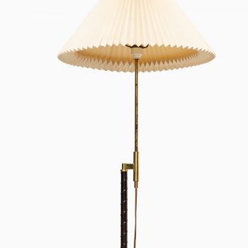 Floor lamp in brass and leather at Studio Schalling