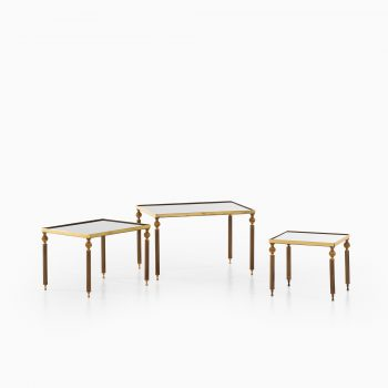 Nesting tables in brass and mirrored glass at Studio Schalling