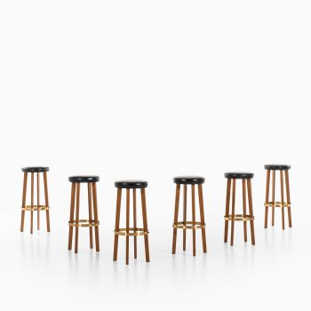 Bar stools in teak and brass at Studio Schalling