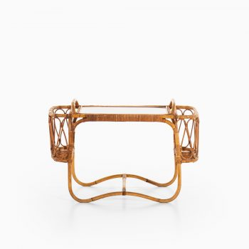 Side table with removable tray in rattan at Studio Schalling