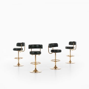 Börje Johanson bar stools in brass and green imitation leather at Studio Schalling