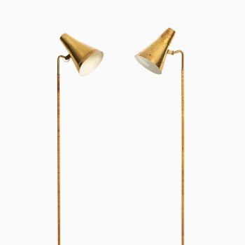 Paavo Tynell floor lamps model K-10 in brass and cane at Studio Schalling